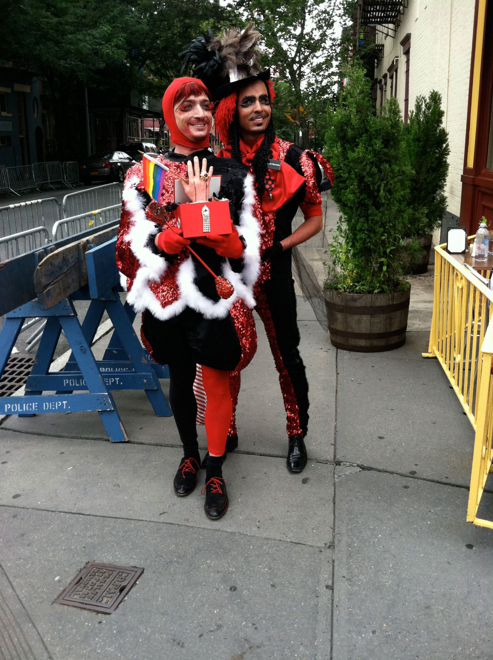 two men in red costumes